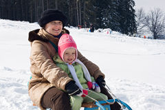 Sledging at winter time Stock Photos
