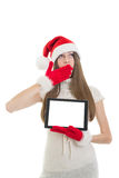 Sleeepy Santa girl showing tablet computer with blank screen Royalty Free Stock Images