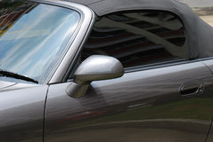 Convertible Car. A Sleek Silver metallic Grey Painted Convertible Luxury Sports Car Royalty Free Stock Images