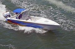 Sleek Twin Outboard Powered Motorboat. Sleek twin outboard engine powered motor boat cruising on the florida intra-coastal waterway royalty free stock images