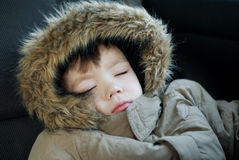 Sleep. Small boy 3 years old is sleeping in car Stock Image