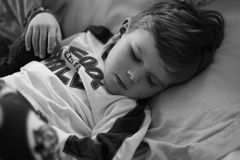 Sleep. Young boy taking a nap Royalty Free Stock Photography