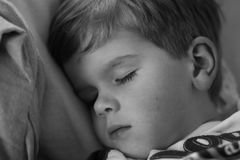 Sleep. Young boy taking a nap Stock Photography