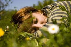 Sleep. Young woman sleep on meadow grass Stock Photo