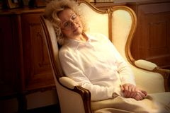 Sleep 58. A senior woman sleep on the arm-chair Royalty Free Stock Photography