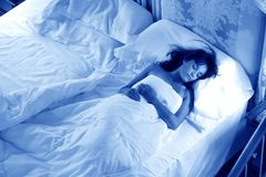 Sleep. A woman sleep in bed on the night Stock Photo