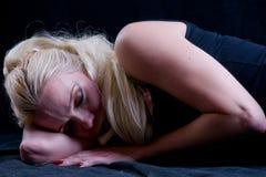 Sleep. Blond woman with long hair sleeping Royalty Free Stock Photography
