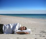 Sleep. Portrait of a business man slepping on the beach Royalty Free Stock Photos