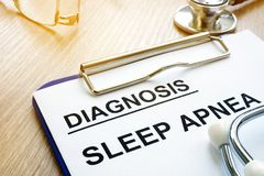 Sleep apnea diagnosis on a clipboard. Sleep apnea diagnosis on the clipboard stock photos