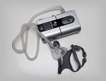 Sleep Apnea Machine. Cpap machine and mask for a sleep apnea image stock images