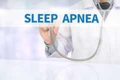 SLEEP APNEA. Medicine doctor hand working on virtual screen stock images