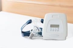 Sleep apnea therapy,CPAP machine with mask Stock Photo