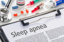 Sleep apnea written on a clipboard. The diagnosis Sleep apnea written on a clipboard stock photos