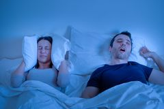 Sleep apnoea disorder in bed and man snore royalty free stock photos
