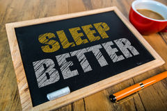 Sleep better. On small blackboard royalty free stock photos