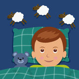 Sleep boy. Boy counting sheep, under the blanket next to a teddy bear Royalty Free Stock Photography