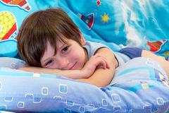 Before sleep. The child poses before going to bed Royalty Free Stock Images