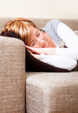Sleep couch. Home sleeping woman on couch in livingroom Royalty Free Stock Photography