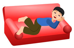 Sleep in couch. A funny looking young boy lazily sleeping on a red couch Stock Image