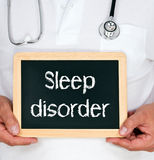 Sleep disorder. A physician or a doctor with a blackboard and text Stock Image
