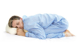 Sleep like a baby. An adult man sleeping like a baby royalty free stock photos