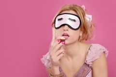Sleep mask blind blonde with temptation Royalty Free Stock Image