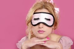 Sleep mask blind blonderelaxed on pink Royalty Free Stock Photo