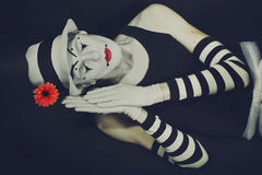 Sleep mime in white hat with red flower Stock Photos