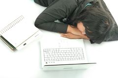 Sleep near by laptop. High angle Royalty Free Stock Images