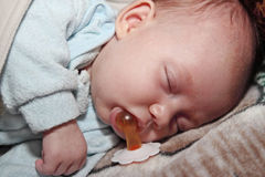 Sleep with a pacifier Royalty Free Stock Photos