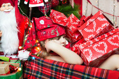 Sleep among the presents Royalty Free Stock Photos