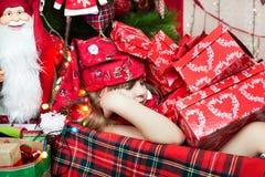 Sleep among the presents Royalty Free Stock Photos