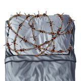 Sleep Problem. And sleeping disorder as sleep apnea or insomnia disease symptoms as a pillow on a bed wrapped with painful barb wire fence as a concept and Royalty Free Stock Photos