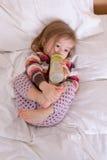 Sleep Rituals. Toddler girl getting ready to sleep, having her drink before fall asleep Royalty Free Stock Photos