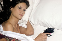 Sleep Safely Woman in Bed Holds Revolver Stock Photos
