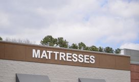 Mattress, Bed and Bedding Store. A sleep shop sells mattresses, bed, and bedding at wholesale prices Royalty Free Stock Images