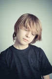 Sleep standing. Schoolboy on gray background Stock Images