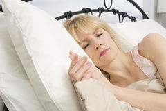 Sleep Time: Middle Age Woman Sleeping. A middle age woman peacefully sleeping Stock Image