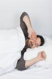 Sleep time - rub eyes Stock Images
