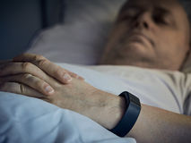 Sleep Tracking. Middle aged man sleeps and the wristband tracking his sleep Stock Photos