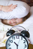 Sleep, wake up with alarm clock Stock Photo