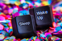 Sleep and wake up buttons. Computer sleep and wake up buttons on a colorful abstract background Royalty Free Stock Photo