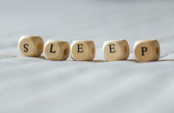 Sleep. Word sleep spelled in alphabet wooden letter blocks stock photo
