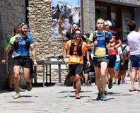 Trail runners pushing hard on their final rush to reach the finish line on Gran Trail Aneto Posets.