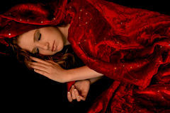 Sleeper. A woman in a red cape sleeps soundly Stock Photography
