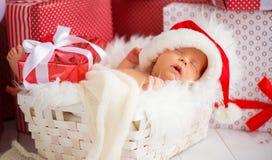 Sleeper newborn baby in  Christmas Santa cap Stock Image