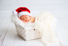Sleeper newborn baby in  Christmas Santa cap Stock Image