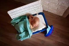 Sleeper newborn baby in white box Stock Photography