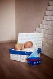 Sleeper newborn baby in white box Royalty Free Stock Image