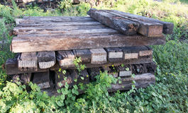 The sleeper railway. this is old wood. Old railway sleeper with iron bolts Royalty Free Stock Images